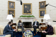 President Joe Biden, accompanied by Vice President Kamala Harris, second from left, National Economic Council director Brian Deese, left, and Treasury Secretary Janet Yellen, right, speaks as he gets his weekly economic briefing in the Oval Office of the White House, Friday, April 9, 2021, in Washington. (AP Photo/Andrew Harnik)