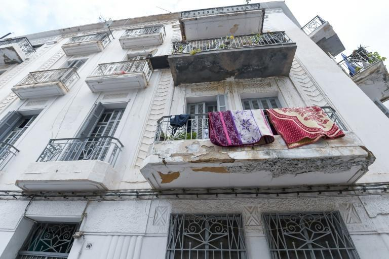 Built by Italian and French architects and businesspeople, decades-old buildings in the Tunisian capital bear the weight of their association with colonialism, with many neglected and turned into garbage dumps (AFP/Fethi Belaid)