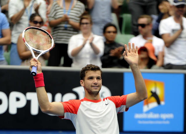 Grigor Dimitrov of Bulgaria celebrates his win over Milos Raonic of Canada during their third round match at the Australian Open tennis championship in Melbourne, Australia, Saturday, Jan. 18, 2014.(AP Photo/Andrew Brownbill)