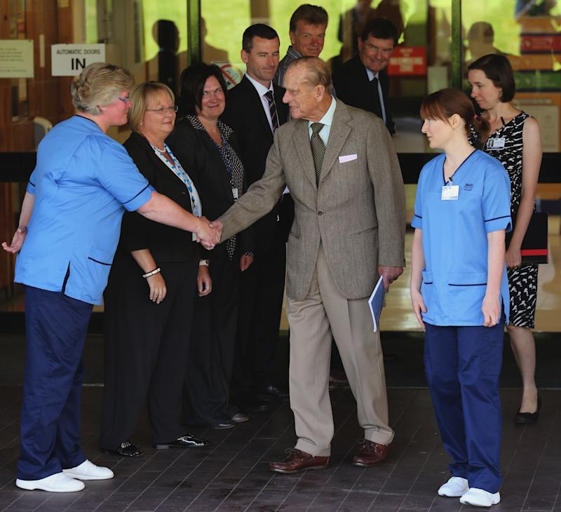 Britain's Prince Philip thanks hospital staff as he leaves Aberdeen Royal Infirmary, Aberdeen, Scotland  Monday Aug. 20, 2012 after five days of treatment for a bladder infection. The 91-year-old husband of Queen Elizabeth II was hospitalized Wednesday with a recurrence of an infection he suffered earlier this summer. Buckingham Palace said Philip was discharged from Aberdeen Royal Infirmary in northeast Scotland was returning to the nearby Balmoral estate, where the royal family is on vacation.    (AP Photo/Andrew Milligan/PA Wire)  UNITED KINGDOM OUT