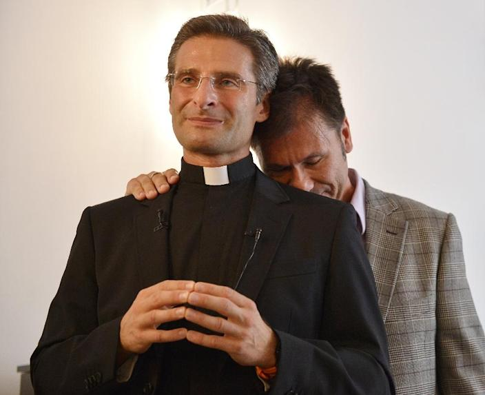 Father Krysztof Olaf Charamsa (L), who had worked for the Vatican until he was fired, gives a press conference with his partner Edouard to reveal his homosexuality on October 3, 2015 in Rome (AFP Photo/Tiziana Fabi)