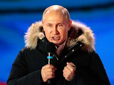 Russian President Vladimir Putin speaks to supporters during a rally near the Kremlin in Moscow. AP