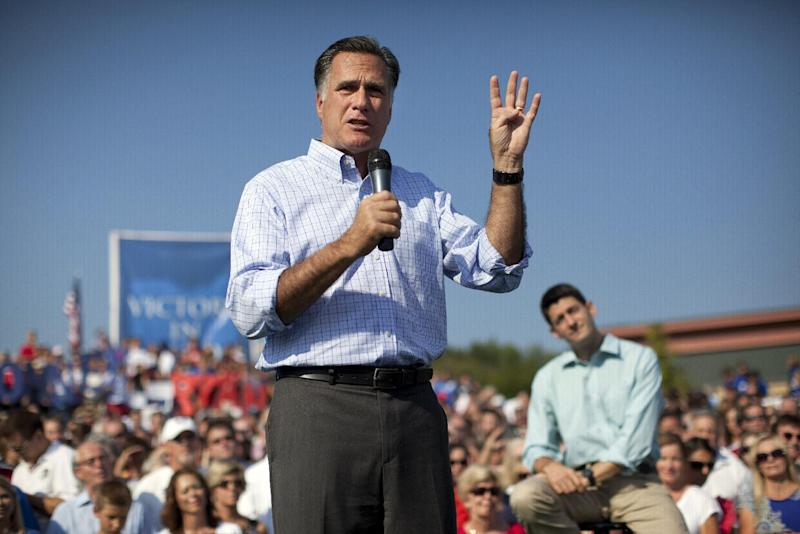 Republican presidential candidate, former Massachusetts Gov. Mitt Romney speaks as vice presidential running mate Rep. Paul Ryan, R-Wis., listens during a campaign rally on Saturday, Aug. 25, 2012 in Powell, Ohio. (AP Photo/Evan Vucci)