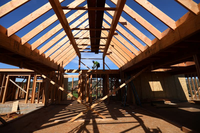FILE PHOTO: Construction worker builds a single family home in San Diego, California