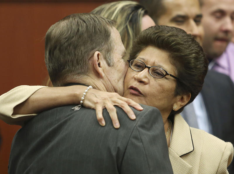 George Zimmerman's parents Robert Zimmerman Sr. and Gladys Zimmerman embrace following George Zimmerman's not guilty verdict in Seminole circuit court in Sanford, Fla. on Saturday, July 13, 2013. Jurors found Zimmerman not guilty of second-degree murder in the fatal shooting of 17-year-old Martin in Sanford, Fla. The six-member, all-woman jury deliberated for more than 15 hours over two days before reaching their decision Saturday night. (AP Photo/Gary W. Green, Pool)