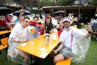 Many hit pubs in the capital and their spirits were dampened by the rain. (PA)