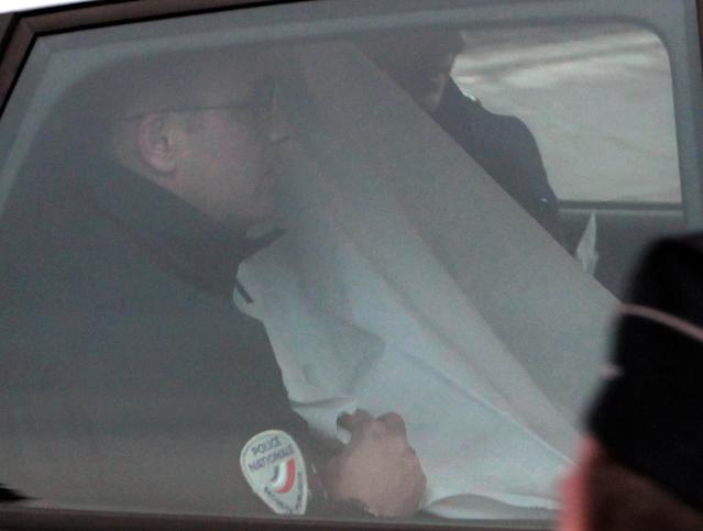 <p>A police car carrying former Panamanian dictator Manuel Noriega, hidden by a white sheet, leaves the Paris courthouse, April 27, 2010. A French judge ordered Noriega jailed pending a trial for money laundering, a decision made only hours after Noriega was extradited from the United States after two decades in a Miami prison. (AP Photo/Thibault Camus) </p>