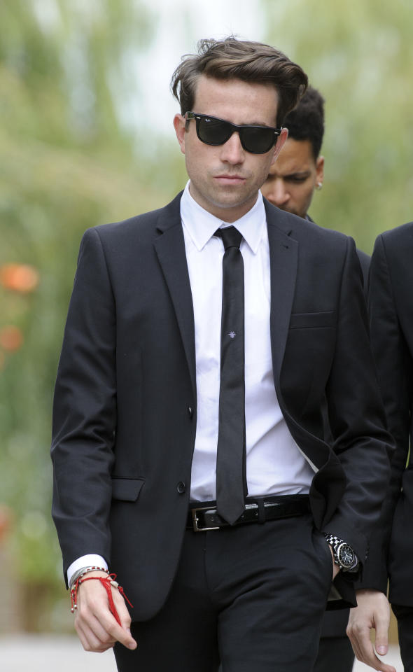 British presenter Nick Grimshaw leaves Edgwarebury Cemetery in London, Tuesday July 26, 2011, after attending the funeral of singer Amy Winehouse. The soul diva, who had battled alcohol and drug addiction, was found dead Saturday at her London home. She was 27.(AP Photo/Jonathan Short)