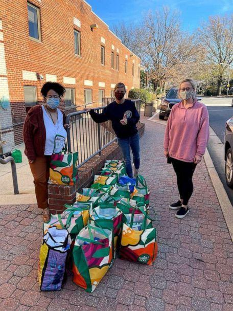 PHOTO: Amber Marchand, center, drops off food her family has collected. (Amber and Sterling Marchand/Be The Good Project)