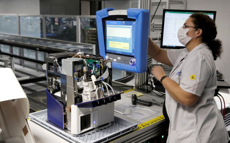 FILE PHOTO: An employee of Hamilton Medical AG tests a ventilator at a plant in Domat/Ems
