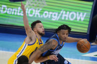 Oklahoma City Thunder forward Josh Hall, right, drives past Golden State Warriors guard Stephen Curry, left, in the first half of an NBA basketball game Wednesday, April 14, 2021, in Oklahoma City. (AP Photo/Sue Ogrocki)