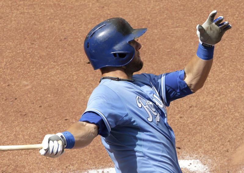 Kansas City Royals' Alex Gordon watches his two-run home run during the fifth inning of a baseball game against the Seattle Mariners on Thursday, Sept. 5, 2013, in Kansas City, Mo. (AP Photo/Charlie Riedel)