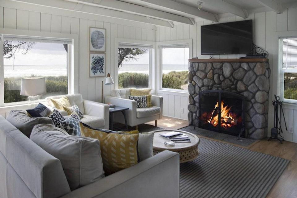 """<strong>Bedrooms:</strong> 2<br> <strong>Bathrooms:</strong> 1<br> <strong>Minimum stay:</strong> 3 nights<br> <br> Another one of the best Oregon coast vacation rentals we've found is this beautiful bungalow with mesmerizing ocean views. Inside, you'll find a wood-burning stove and coastal decor. Outside, you can take in the unforgettable scenery in Adirondack chairs and relax happily with your loved ones—including those with paws, as this space is pet-friendly. $375, Vrbo (Starting Price). <a href=""""https://www.vrbo.com/640219"""" rel=""""nofollow noopener"""" target=""""_blank"""" data-ylk=""""slk:Get it now!"""" class=""""link rapid-noclick-resp"""">Get it now!</a>"""