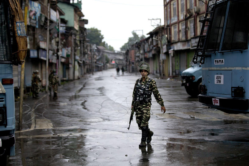 FILE - In this Wednesday, Aug. 14, 2019  file photo, an Indian paramilitary soldier patrols during security lockdown in Srinagar, Indian controlled Kashmir. Gulf Arab countries have remained mostly silent as India's government moved to strip the Indian-administered sector of Kashmir of its limited autonomy, imposing a sweeping military curfew in the disputed Muslim-majority region and cutting off residents from all communication and the internet. (AP Photo/ Dar Yasin, File)
