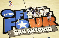 FILE - Connecticut players celebrate following the women's NCAA Final Four college basketball championship game against Stanford in San Antonio, in this Tuesday, April 6, 2010, file photo. Connecticut won 53-47. The San Antonio region will host the entire NCAA women's basketball tournament. The move Friday, Feb. 5, 2021, was made to help mitigate the risks of COVID-19 and matches that of the men's tournament, which the NCAA said last month will be played in the Indianapolis area.(AP Photo/Eric Gay, File)