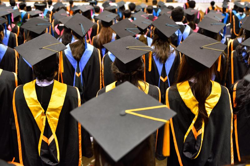 Large Group Of Students Looking Ahead During Graduation Ceremony