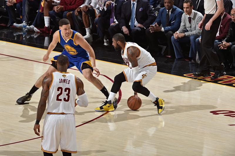 Klay Thompson makes Kyrie Irving work to get open. (David Liam Kyle/NBAE/Getty Images)