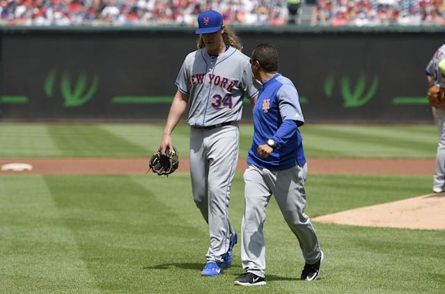 Noah Syndergaard exits with an injury after 1.1 innings in Washington. (AP Photo/Nick Wass)
