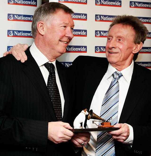 LONDON - APRIL 15: Manager of Manchester United, Sir Alex Ferguson presents former footballer Denis Law with his Lifetime Achievement Award during the HMV Football Extravaganza to Honour Denis Law at the Hilton Park Lane on April 15, 2008 in London, England. (Photo by Chris Jackson/Getty Images)