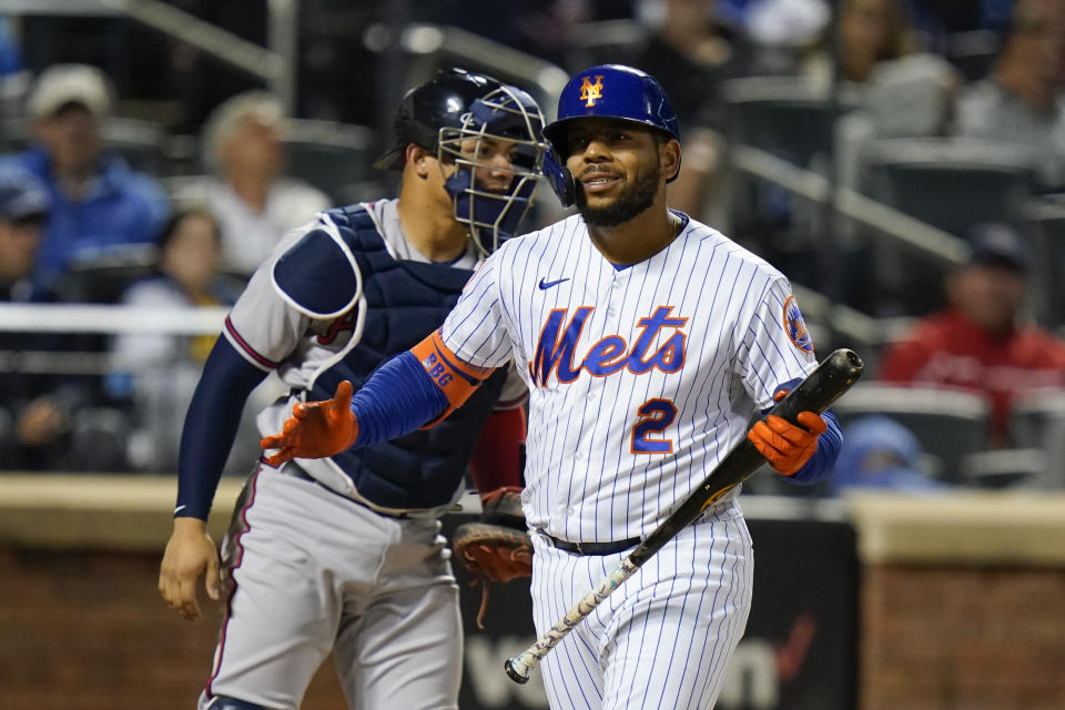 New York Mets' Dominic Smith (2) reacts after striking out during the fourth inning of a baseball game against the Atlanta Braves Tuesday, June 22, 2021, in New York. (AP Photo/Frank Franklin II)