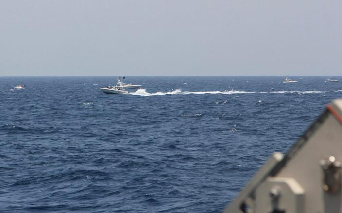 An Iranian fast in-shore attack craft was close to US vessels in the strait - AP