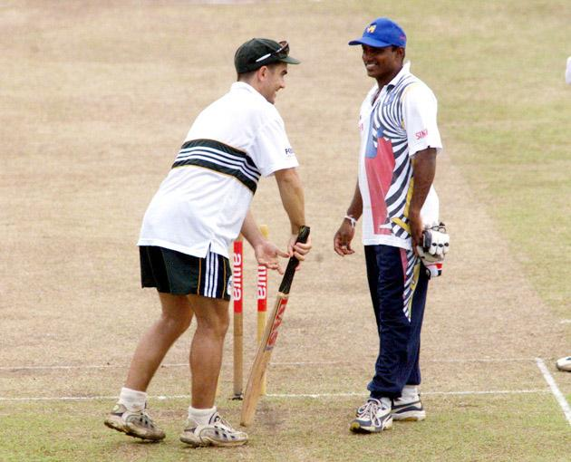 2 Oct 1999:  Justin Langer of Australia talks with Aravinda de Silva while a sodden outfield prevents play from starting on time, on day four of the 3rd Test between Sri Lanka and Australia at Singhalese Sports Club, Colombo, Sri Lanka.X Mandatory Credit: Hamish Blair/ALLSPORT