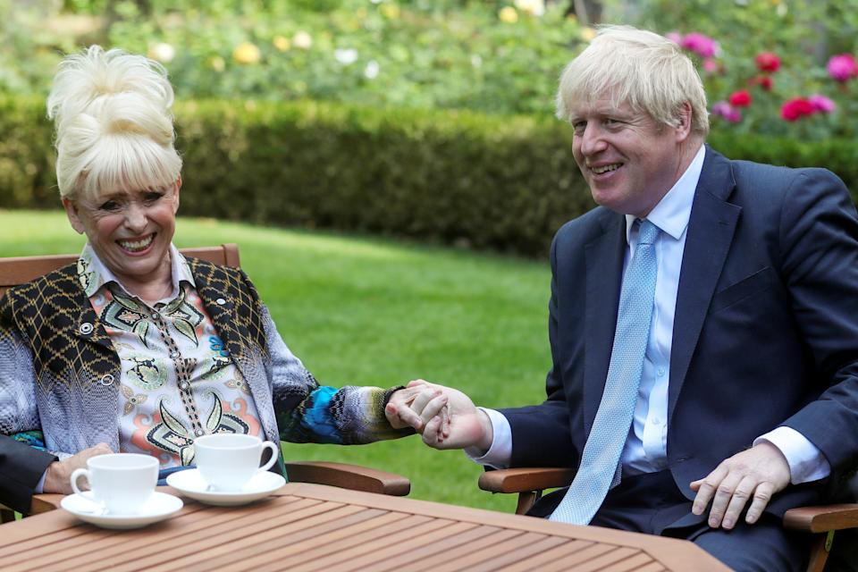 LONDON, ENGLAND - SEPTEMBER 02: Prime Minister Boris Johnson has a cup of tea with television actress Dame Barbara Windsor during a meeting in London on September 2, 2019 in London, England. Barbara Windsor, who suffers from Alzheimers, met with the Prime Minister at 10 Downing Street to discuss dementia care. (Photo by Simon Dawson - WPA Pool/Getty Images)