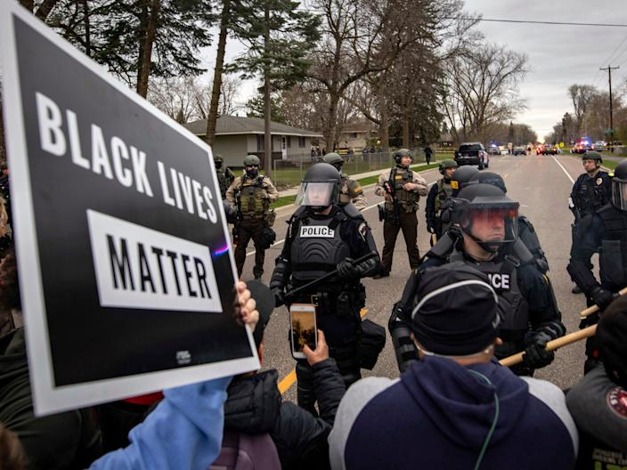 Protesters clash with police, Sunday, April 11, 2021, in Brooklyn Center, Minnesota.