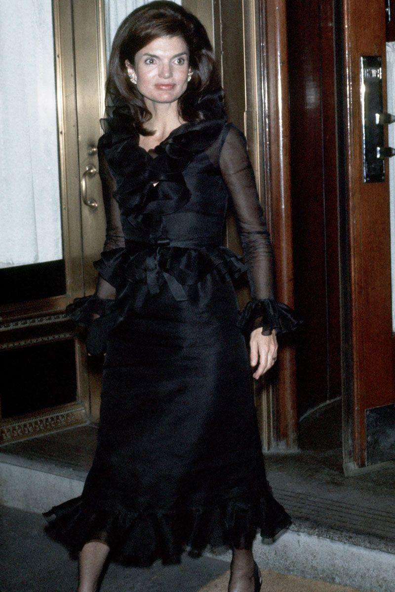 <p>In true '70s style, Jackie O. stepped out of her New York City apartment wearing a chic chiffon- and ruffled-sleeved black dress. </p>