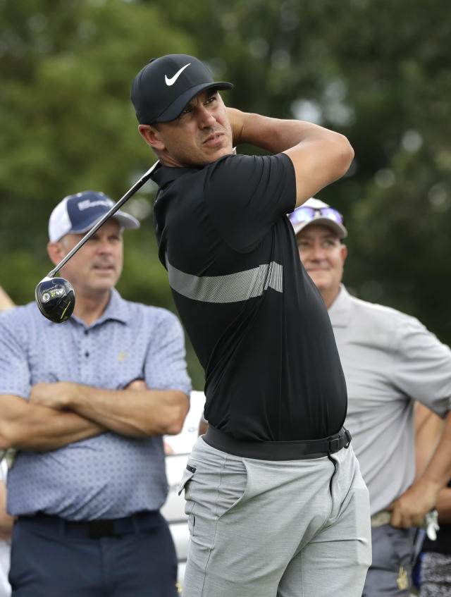 Brooks Koepka watches his tee shot on the ninth hole during the pro-am round of the BMW Championship golf tournament at Medinah Country Club, Wednesday, Aug. 14, 2019, in Medinah, Ill. (AP Photo/Nam Y. Huh)