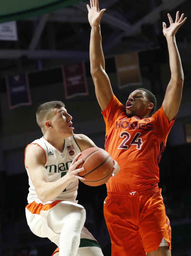 Miami guard Dejan Vasiljevic, left, goes up for a shot against Virginia Tech forward Kerry Blackshear Jr. (24) during the first half of an NCAA college basketball game Wednesday, Jan. 30, 2019, in Coral Gables, Fla. (AP Photo/Wilfredo Lee)