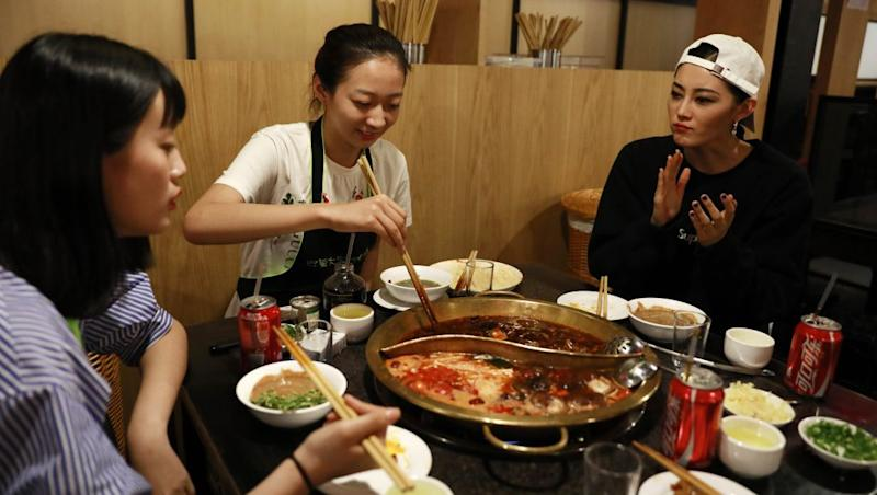 Chinese model Sun Yichao (R) and her juniors Jiang Ruiqi (L) and Li Yuzu from the same modelling agency have a hotpot dinner at a restaurant after the Melody Cashmere show during the Mercedes-Benz China Fashion Week at the Beijing Hotel banquet hall venue in Beijing, China, 29 March 2017. One of China's most promising up and coming fashion model, the 23-year-old Sun Yichao is a striking figure on the runway. At 1.79 metres tall, the svelte model with beautiful chiseled features is high in demand domestically and abroad, having walked the catwalks of Paris, Milan and New York's fashion weeks for major brands like Christian Dior and Chanel. She was also one of the recipients of the 'China Top Ten Professional Fashion Model Award' in 2016. EPA/HOW HWEE YOUNG PLEASE REFER TO ADVISORY NOTICE (epa05887201) FOR FULL PACKAGE TEXT
