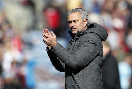 Manchester United manager Jose Mourinho applauds fans after the match