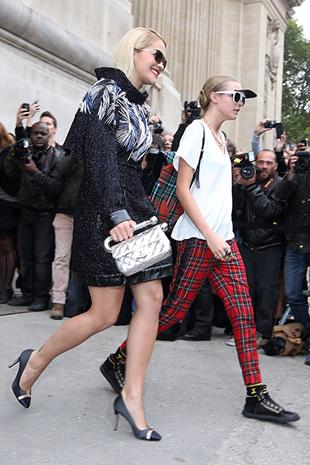"""<div class=""""caption-credit"""">Photo by: Getty Images</div><div class=""""caption-title""""></div>Rita Ora and Cara Delevingne These two Brit It girls are known for their punk-meets-sporty aesthetics and are always pushing the style envelope. We love this pairing from the Chanel show last fall. Feathers, tweed, visors, metallics, and plaid-what more could you ask for?"""