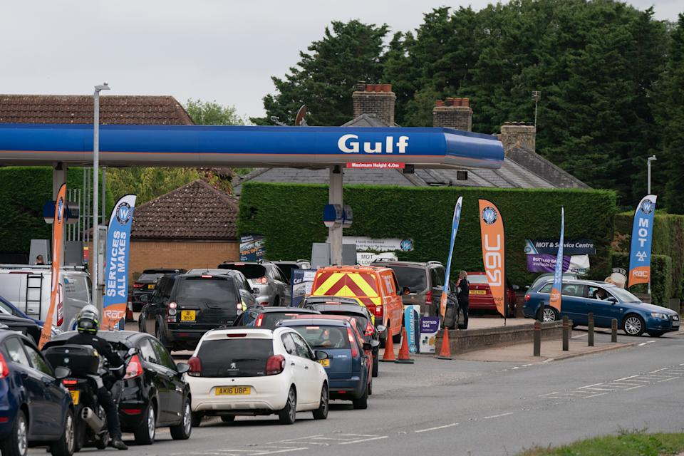 People queue for fuel at a petrol station in Barton, Cambridgeshire. Picture date: Tuesday September 28, 2021.