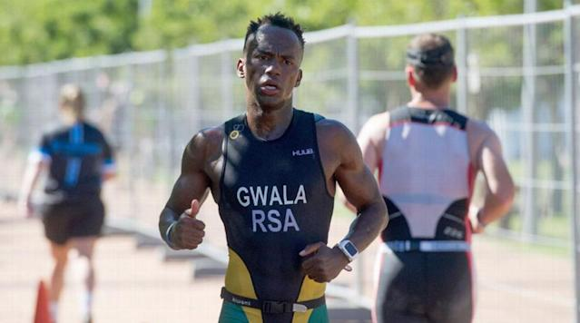 """<p>JOHANNESBURG (AP) — Assailants in South Africa attacked a top national triathlete who was cycling to a training session and cut into his legs with a blunt saw, causing severe injuries, an athletic director said Wednesday.</p><p>Mhlengi Gwala, 27, was undergoing surgery after the attack which occurred before dawn on Tuesday in the coastal city of Durban, said Dennis Jackson, director of the elite athlete program for KwaZulu-Natal province.</p><p>Several attackers pulled Gwala off his bicycle as he cycled up a steep hill and sawed into his right calf, damaging muscle, nerves and bone, according to Jackson, who spoke by phone to the triathlete about the ordeal. They missed a main artery and surgeons are confident they can save the leg, Jackson said.</p><p>The attackers also started sawing into Gwala's left leg before fleeing, enabling the athlete to crawl to a road and flag down a passing car to take him to a hospital.</p><p>The grisly attack has alarmed athletes in Durban who routinely get up in the early morning darkness to train when few people are on the roads, and there was no immediate explanation for why Gwala was targeted. The athlete had offered his cell phone, wallet and bicycle to the assailants, who still went for his legs and were speaking in a language that Gwala could not understand, Jackson said.</p><p>""""I have never heard of any enemies that he may have,"""" he said. """"He is a wonderful ambassador for the sport.""""</p><p>Gwala became an excellent athlete after overcoming drug and alcohol addictions, representing South Africa at international competitions in Chicago in 2015 and in the Netherlands last year, Jackson said. The athlete's long term goals were to compete in half and whole ironman triathlons, which include swimming, cycling and running.</p><p>South Africa's deputy sports minister, Gert Oosthuizen, described the attack on the """"star athlete"""" as """"totally unacceptable"""" and said police are investigating.</p><p>Triathlete Henri Schoeman, who won bronze"""