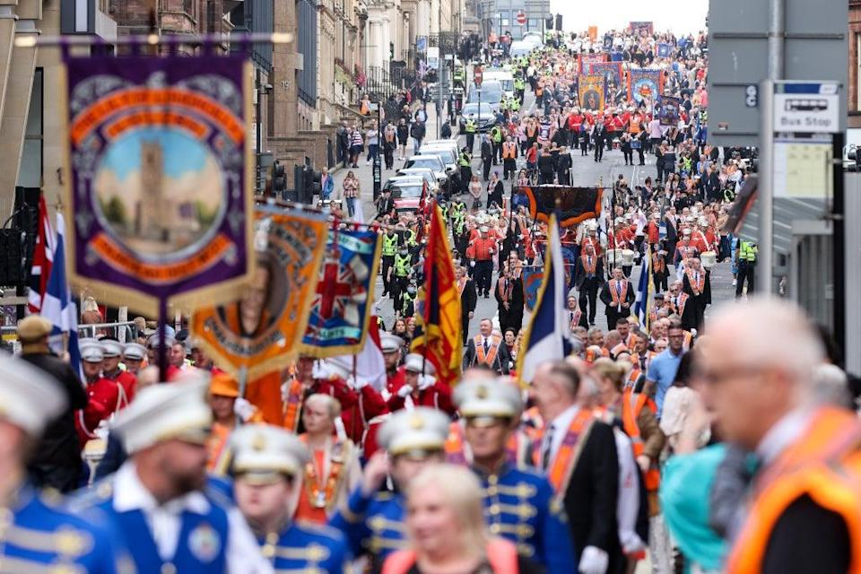 Members of the County Grand Orange Lodge take part in the annual Orange walk parade through the city centre of Glasgow (Robert Perry/PA) (PA Wire)