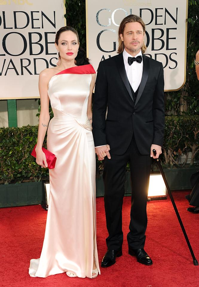 BEVERLY HILLS, CA - JANUARY 15:  Actors Angelina Jolie and Brad Pitt arrive at the 69th Annual Golden Globe Awards held at the Beverly Hilton Hotel on January 15, 2012 in Beverly Hills, California.  (Photo by Jason Merritt/Getty Images)