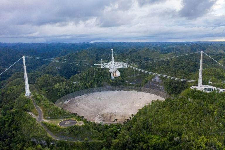 An aerial view of the Arecibo Observatory in Arecibo, Puerto Rico on November 19, 2020. The famed telescope will be decommissioned because the rupture of support cables have made it dangerous