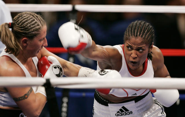 FILE - In this Nov. 11, 2006, file photo, Laila Ali, right, throws a puch at Shelly Burton during the fourth round of a boxing match at Madison Square Garden in New York. Ali won with a TKO in the fourth round. Laila Ali is among the first female fighters to appear on the ballot for the 2020 class of the International Boxing Hall of Fame, Tuesday, Oct. 1, 2019. (AP Photo/Frank Franklin II, File)