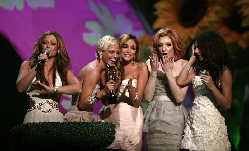 Girls Aloud collect their award for British Single on stage, during the BRIT Awards, at Earls Court, central London, SW5.