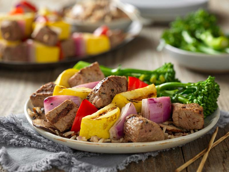 A flavorful, tenderizing marinade gives the kabobs of steak, onion, squash and peppers a unique and savory taste.