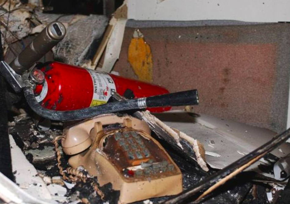 <p>A melted telephone sits alongside a small fire extinguisher on the fifth floor of the Pentagon. (Air Force photo by Staff Sgt. Larry A. Simmons) </p>