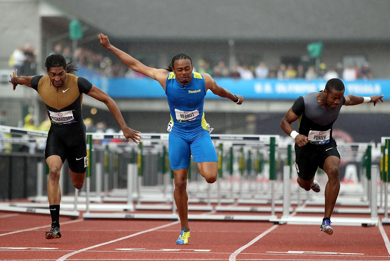 EUGENE, OR - JUNE 30:  Aries Merritt (C) crosses the finish line to win the Men's 110 Meter Hurdles Final ahead of Jason Richardson (L) and Jeffrey Porter (R) on day nine of the U.S. Olympic Track & Field Team Trials at the Hayward Field on June 30, 2012 in Eugene, Oregon.  (Photo by Christian Petersen/Getty Images)
