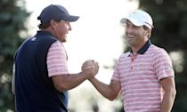Phil Mickelson and Kevin Kisner of the US Team celebrate on the 18th green after defeating Marc Leishman and Jason Day the International Team during the Presidents Cup, at Liberty National Golf Club in Jersey City, on September 29, 2017 (AFP Photo/SAM GREENWOOD)