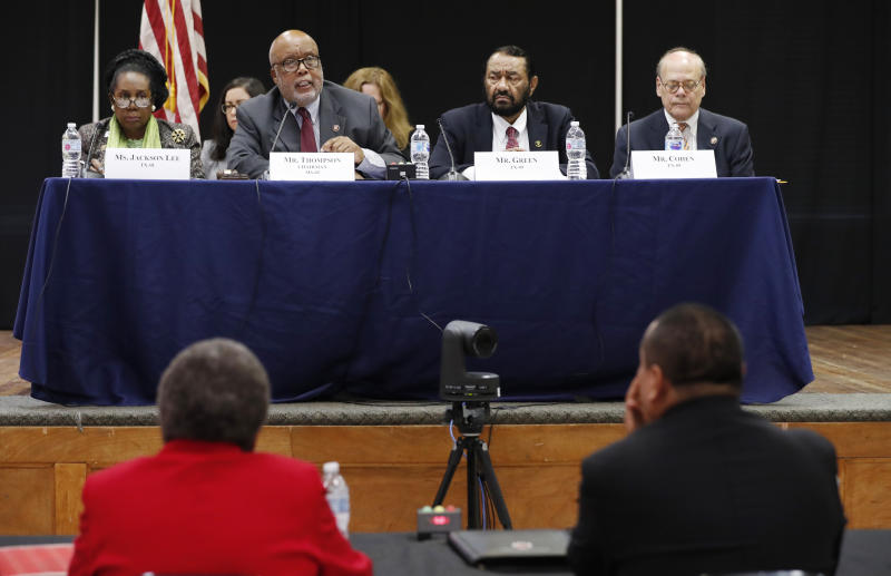 House Homeland Security Committee chairman, U. S. Rep. Bennie Thompson, D-Miss., second from left, and a panel of witnesses, in the foreground, during a field hearing at Tougaloo College in Jackson, Miss., Thursday, Nov. 7, 2019, about the Aug. 7, 2019 ICE raid in Mississippi which resulted in nearly 700 workers being arrested at seven chicken processing plants. (AP Photo/Rogelio V. Solis)