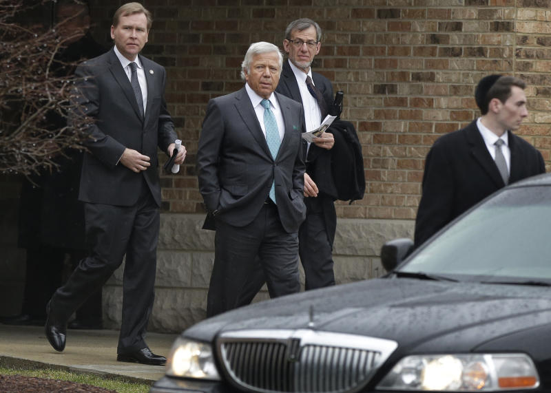 Robert Kraft, owner of the New England Patriots NFL football team, center left, departs funeral services for 17-year-old Sam Berns at Temple Israel, Tuesday, Jan. 14, 2014, in Sharon, Mass. Berns died Friday after complications from Hutchinson-Gilford progeria syndrome, commonly known as progeria, a rare genetic condition that accelerates the aging process. Other men in photo are unidentified. (AP Photo/Steven Senne)