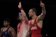 United States' David Morris Taylor III, right, celebrates defeating India's Deepak Punia compete in the men's 86kg Freestyle semifinal wrestling match at the 2020 Summer Olympics, Wednesday, Aug. 4, 2021, in Chiba, Japan. (AP Photo/Aaron Favila)