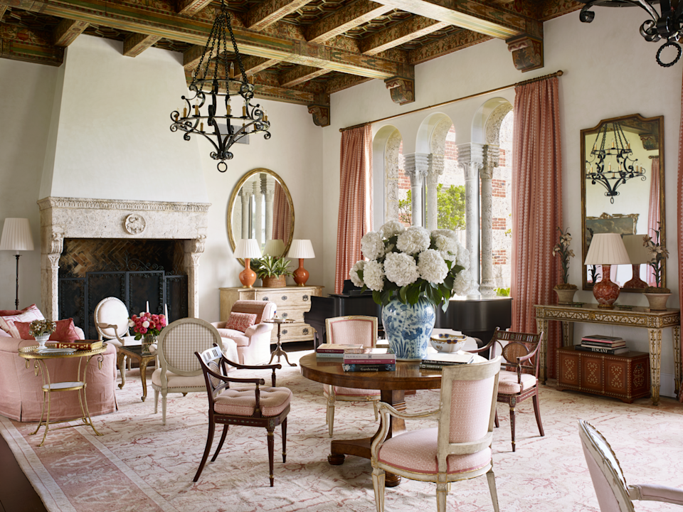 """<p>Affectionally called the """"ham-and-cheese"""" house by Palm Beach locals, this <a href=""""https://www.veranda.com/decorating-ideas/g25422813/0082-0093-original-thinking-january-2019/"""" rel=""""nofollow noopener"""" target=""""_blank"""" data-ylk=""""slk:red brick and coral stone manse"""" class=""""link rapid-noclick-resp"""">red brick and coral stone manse</a> overlooking the ocean was built by legendary architect Maurice Fatio in 1928. It was purchased years many later by a Connecticut couple who asked designer <a href=""""https://susanzisesgreen.com/"""" rel=""""nofollow noopener"""" target=""""_blank"""" data-ylk=""""slk:Susan Zises Green"""" class=""""link rapid-noclick-resp"""">Susan Zises Green</a> to transforms its Gilded Age grandeur into modern-day livability. The living room's pinks, creams, and corals echo a collection of seashells.</p><p><a class=""""link rapid-noclick-resp"""" href=""""https://www.veranda.com/decorating-ideas/g25422813/0082-0093-original-thinking-january-2019/"""" rel=""""nofollow noopener"""" target=""""_blank"""" data-ylk=""""slk:Tour the Home"""">Tour the Home</a></p>"""