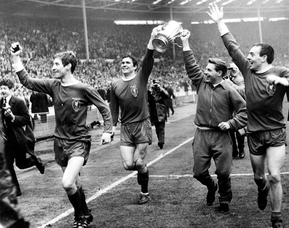 St John, right, celebrates Liverpool's FA Cup victory with his teammates, l-r, Geoff Strong, Ron Yeats and Gordon Milne - Popperfoto via Getty Images